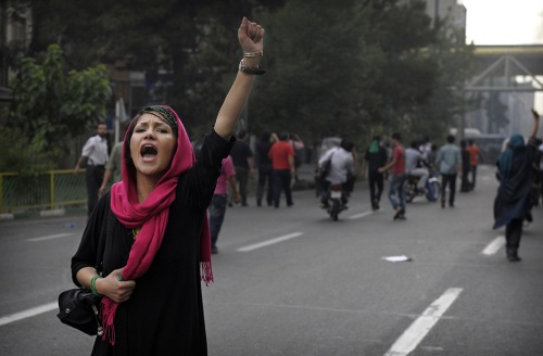 A supporter of defeated Iranian presidential candidate Mir Hossein Mousavi shouts slogans during riots in Tehran on June 13, 2009.