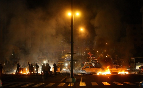 Protestors set fires in a main street in Tehran, Iran in the early hours of Monday, June 15, 2009. Iran's supreme leader ordered Monday an investigation into allegations of election fraud, marking a stunning turnaround by the country's most powerful figure and offering hope to opposition forces who have waged street clashes to protest the re-election of President Mahmoud Ahmadinejad. (AP Photo) #