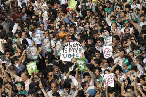 On Monday, June 15, 2009, Iranian opposition demonstrators protest in support of defeated presidential candidate Mir Hossein Mousavi, in Tehran. Opposition supporters defied a ban to stage a mass rally in Tehran in protest at President Mahmoud Ahmadinejad's landslide election win, as Iran faced a growing international backlash over the validity of the election and the subsequent crackdown on opposition protests. (BEHROUZ MEHRI/AFP/Getty Images) #