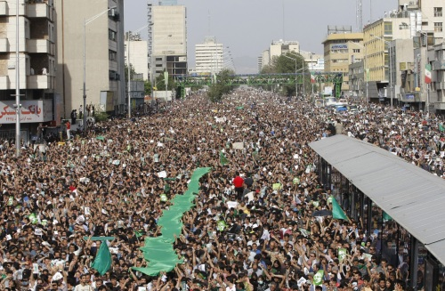 Defying an official ban, hundreds of thousands of Iranian supporters of Mir Hossein Mousavi demonstrate in Tehran on Monday, June 15, 2009. (BEHROUZ MEHRI/AFP/Getty Images) #